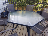 Glass patio table, and 6 patio chairs