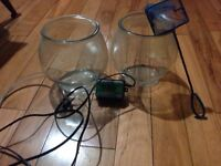 Two fish bowl aquariums with pump and net