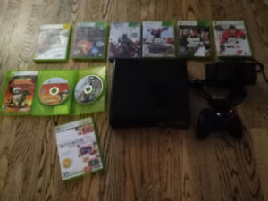 Xbox 360 with one controller and 9 games. $75