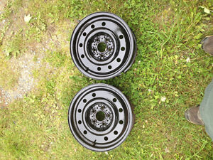 "2 - 15"" 5hole x100 mm metal rims - $30 . Each"