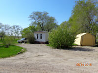 Mobile home on three lots, 8 miles from yorkton.