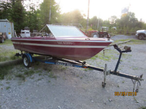 15 feet boat , motor and trailer