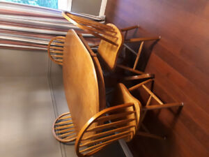 Kitchen table with 4 chairs- solid wood. $20