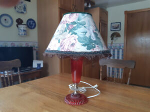 Older red and clear glass table lamp