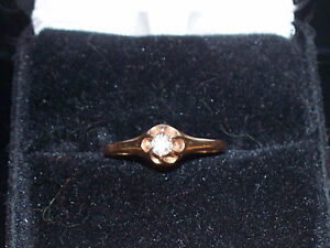 14 kt ladies solitaire ring size 7