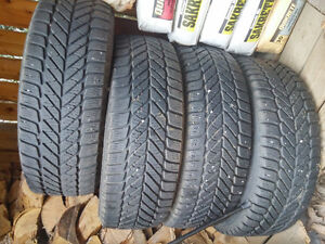 """P215/60R16 16"" all season Goodyear Ultra Grip tires on rims"""