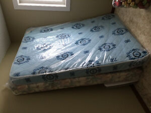 Queen box spring and mattress.