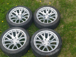 18 inch low profile tires with rims, from BMW 545i