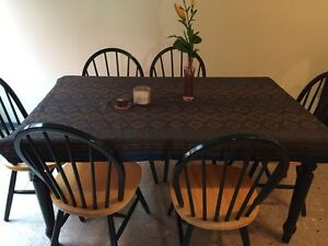 Wooden table and matching chairs