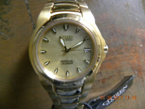 NEW WITH TAGS CITIZEN PERPTUAL CALENDAR gold toned