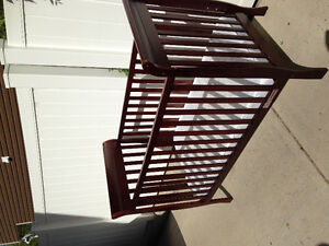 Dark finished, solid wood with mattress baby crib for sale