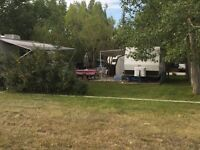 RV Lot with Two Trailers at CWR Boat Club. Cowley AB