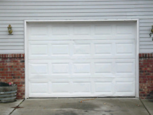Wanted - 2  7ft x 9ft insulated garage doors