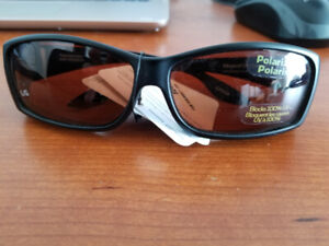 Sunglasses that fit over eyeglasses.