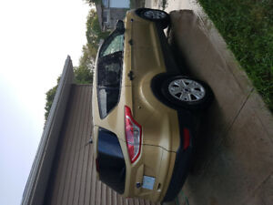 Very nice Ford Escap 2014 gold color for cheaper price