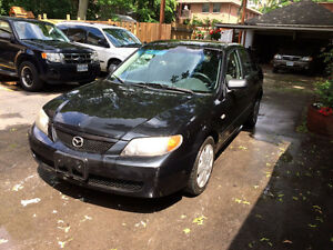 For Sale Black Mazda Protege 2003.