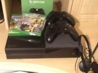 Xbox One with two games, two controllers and headset