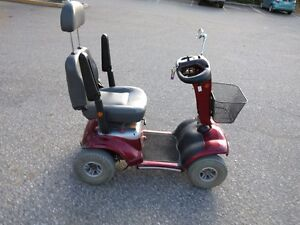 ELECTRIC MOBILIT{Y SCOOTER