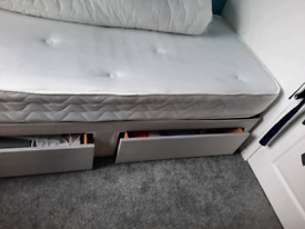 Single grey bed with mattress and storage drawers