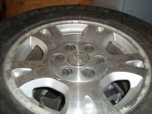 four 17 in 2009 chev 1500 4x4 alloy rims and centers