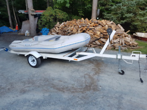 9 ft inflatable, 5 hp honda  4 stroke, inspected trailer