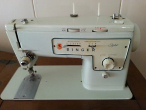Singer sewing machine in fold away cabinet