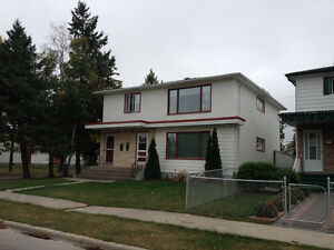 Main and upper floors of large renovated duplex in east kildonan