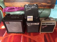 Collection of guitar amps.