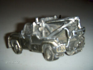 VINTAGE TOW TRUCK BELT BUCKLE AND A MATCHING HAT PIN