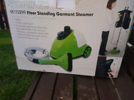 brand new steam iron green and white with clothes hanger