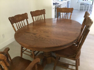 Beautiful Oak table with six chairs $500.00
