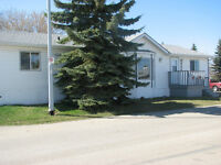 Perfect family home right across from school! Only $152,900
