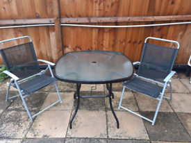 Glass top garden table with two chairs