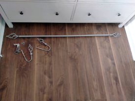 SILVER CURTAIN POLE AND HOLD BACKS