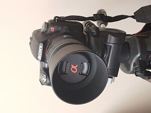 Sony dslr with two lenses, tripod, and large lowepro backpack ca
