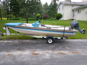14 foot fibreglass boat trailer and motor for sale.