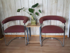 Two fabric chairs with side table