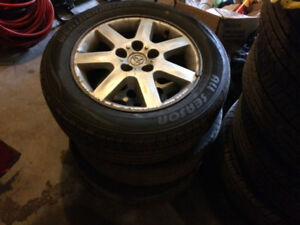 """16"""" Toyota rims and all season tires"""
