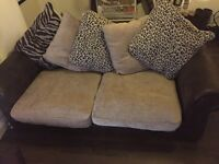 5ft brown /beige/animal print sofa . Used for 6months