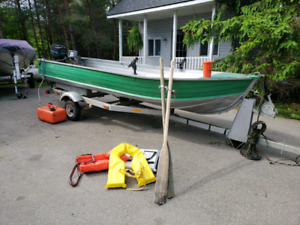 14 ' aluminum boat with 7.5 merc motor on trailer $1800.00