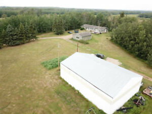 Great opportunity with 19+ acres, bungalow + SHOP in strathcona