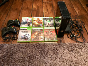 XBOX 360, 2 remotes, 6 games, cords.  $50, OBO.