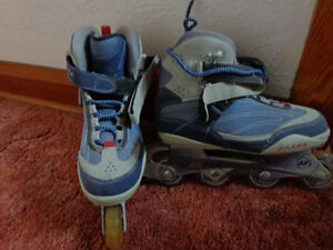 ROLLER BLADES - LIKE NEW.
