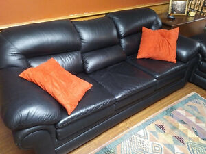 Black leather couch, love seat and chair.  Great condition.