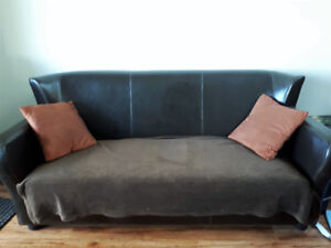 Faux leather apartment-sized couch and accent chair
