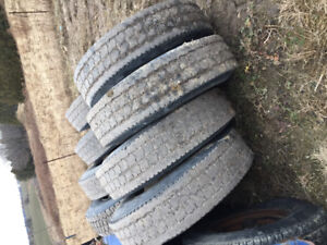 Used Heavy Truck Tires on white steel rims