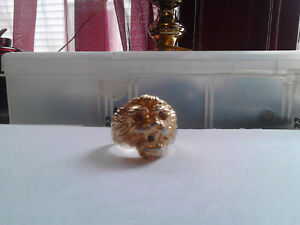 gold tone-plated lions head ring..its a big size ans some gold f