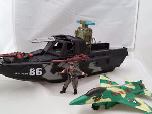 Toy military ship with plane and figure