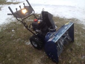 11tp 208cc. snowblower with electric start.