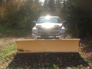 Dodge. 3500 Ram Truck with Fisher Plow